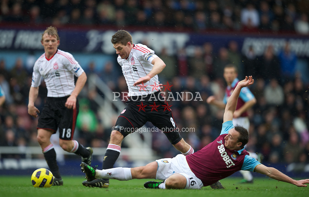 LONDON, ENGLAND - Sunday, February 27, 2011: Liverpool's captain Steven Gerrard MBE is fouled by West Ham United's Mark Noble during the Premiership match at Upton Park. (Photo by David Rawcliffe/Propaganda)