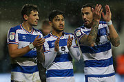 QPR midfielder Pawel Wszolek (23) QPR midfielder Massimo Luongo (21) and QPR defender Geoff Cameron (5) applaud the crowd after their side's 3-2 victory against Brentford during the EFL Sky Bet Championship match between Queens Park Rangers and Brentford at the Loftus Road Stadium, London, England on 10 November 2018.