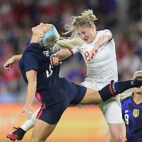 United States midfielder Julie Ertz (8) heads the ball in front of England forward Ellen White (18) during the first match of the 2020 She Believes Cup soccer tournament at Exploria Stadium on 5 March 2020 in Orlando, Florida USA.