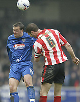 Photo: Aidan Ellis.<br /> Lincoln City v Grimsby Town. Coca Cola League 2, Play off Semi Final. 13/05/2006.<br /> Grimsby's Gary Jones battles with Lincoln's Jamie McCombe