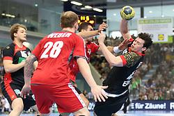 03.04.2016, Schwalbe Arena, Gummersbach, GER, Testspiel, Deutschland vs Oesterreich, im Bild Robert Weber (#28, Oesterreich) und Janko Bozovic (#7, Oesterreich) stoppen Simon Ernst (#40, Deutschland) // during the International Handball Friendly Match between Germany and Austria at the Schwalbe Arena in Gummersbach, Germany on 2016/04/03. EXPA Pictures © 2016, PhotoCredit: EXPA/ Eibner-Pressefoto/ Deutzmann<br /> <br /> *****ATTENTION - OUT of GER*****