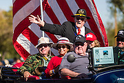 "11 NOVEMBER 2013 - PHOENIX, AZ: Veterans ride in the Phoenix Veterans Day Parade. The Phoenix Veterans Day Parade is one of the largest in the United States. Thousands of people line the 3.5 mile parade route and more than 85 units participate in the parade. The theme of this year's parade is ""saluting America's veterans.""    PHOTO BY JACK KURTZ"
