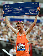 Tom Bosworth of Great Britain celebrates receiving a winners cheque after winning the Men's 3000m Race Walk during the Muller Anniversary Games, Day One, at the London Stadium, London, England on 21 July 2018. Picture by Martin Cole.