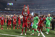 CHAMPIONS Liverpool defender Virgil van Dijk (4) lifts the Champions League Trophy after the UEFA Champions League Final match between Tottenham Hotspur and Liverpool at Wanda Metropolitano Stadium, Madrid, Spain on 1 June 2019.