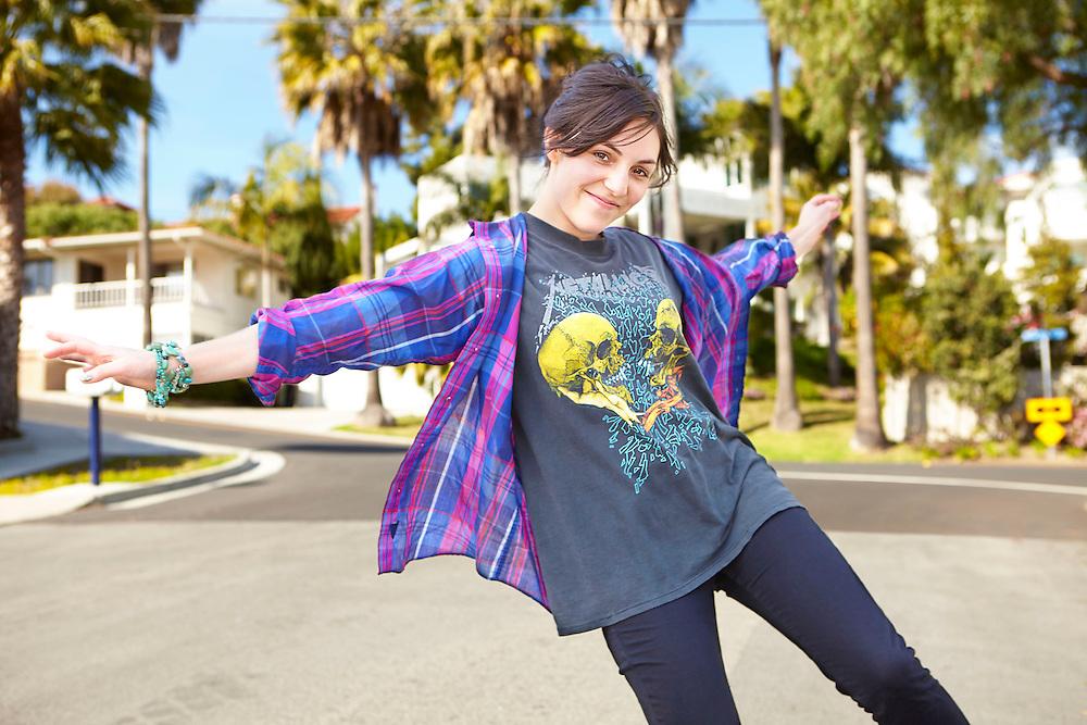 Lifestyle image of playful girl walking around in Orange County Southern California