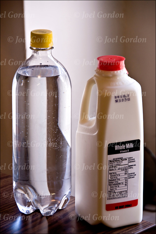 Liter water and quart of milke. The volume of a liter is about 6 percent larger that the volume of a quart