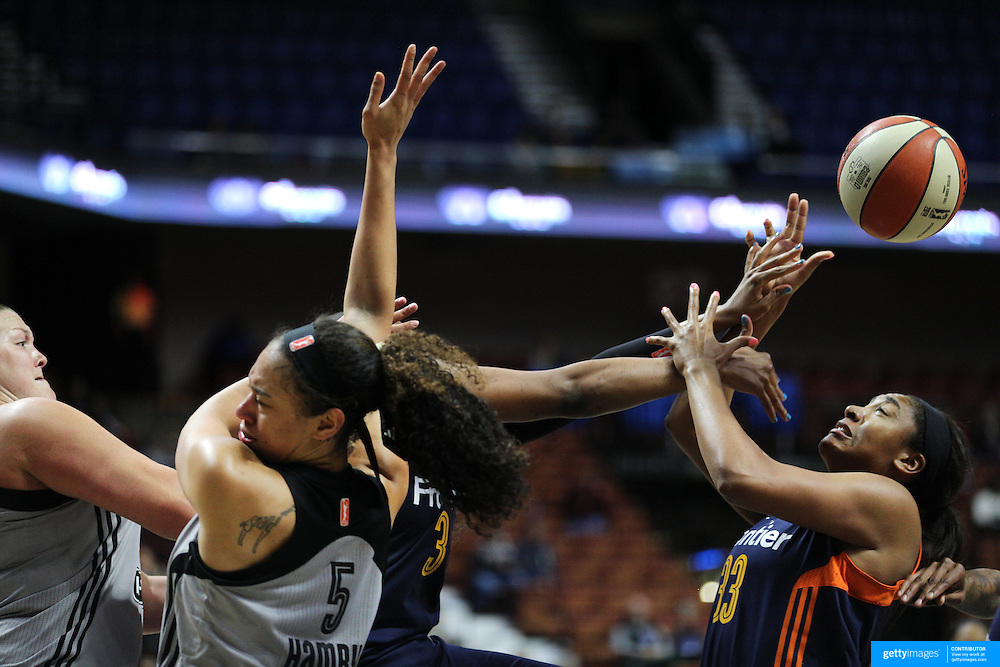 UNCASVILLE, CONNECTICUT- MAY 05: Morgan Tuck #33, (right), of the Connecticut Sun challenges for a rebound with Dearica Hamby #5 of the San Antonio Stars during the San Antonio Stars Vs Connecticut Sun preseason WNBA game at Mohegan Sun Arena on May 05, 2016 in Uncasville, Connecticut. (Photo by Tim Clayton/Corbis via Getty Images)