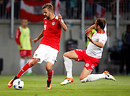 Lukas Hinterseer of Austria and Andrei Agius of Malta during the International Friendly match at Worthersee Stadion, Klagenfurt, Austria.<br /> Picture by EXPA Pictures/Focus Images Ltd 07814482222<br /> 31/05/2016<br /> ***UK &amp; IRELAND ONLY***<br /> EXPA-JAN-160531-5366.jpg
