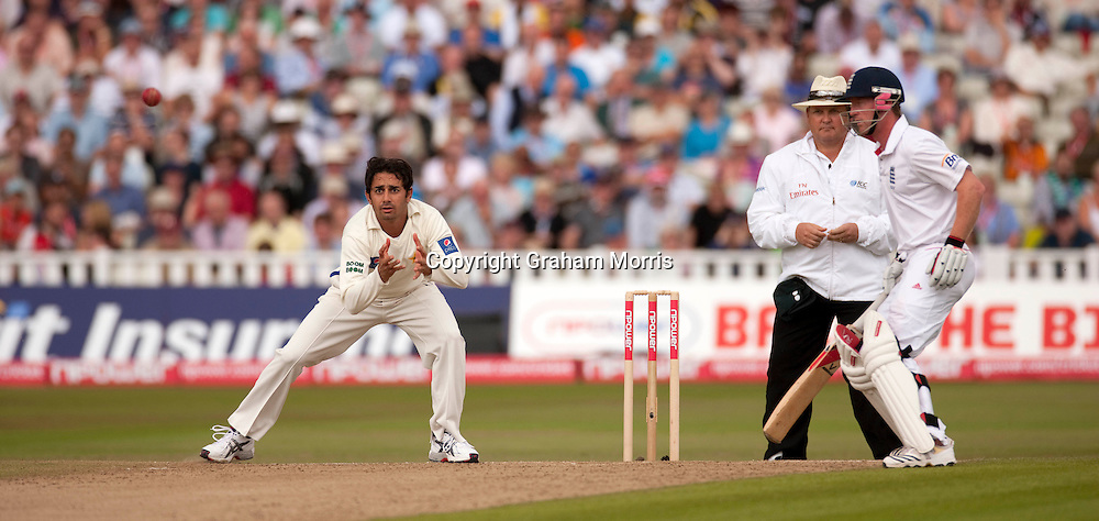 Saeed Ajmal fields off his own bowling (plus Paul Collingwood) during the second npower Test Match between England and Pakistan at Edgbaston, Birmingham.  Photo: Graham Morris (Tel: +44(0)20 8969 4192 Email: sales@cricketpix.com) 07/08/10