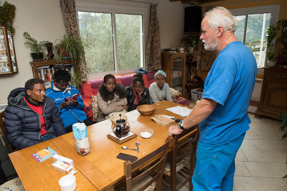 November 9, 2016,  Breil-sur-Roya, French Alpes, France. Sylvain, 67 years, a retired school teacher, talks in his home with 5 Eritrean refugees he just welcomed. By doing so Sylvain risks police arrests and a trial.<br /> <br /> 9 novembre 2016, Breil-sur-Roya, Alpes fran&ccedil;aises, France. Sylvain, 67 ans, prof &agrave; la retraite, chez lui avec 5 r&eacute;fugi&eacute;s &eacute;rythr&eacute;ens qu'il vient d'accueillir. Sylvain risque ainsi une arrestation et un proc&egrave;s.