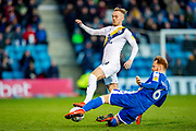 Oxford United midfielder Mark Sykes (18) and Gillingham FC defender Connor Ogilvie (6) during the EFL Sky Bet League 1 match between Gillingham and Oxford United at the MEMS Priestfield Stadium, Gillingham, England on 18 January 2020.