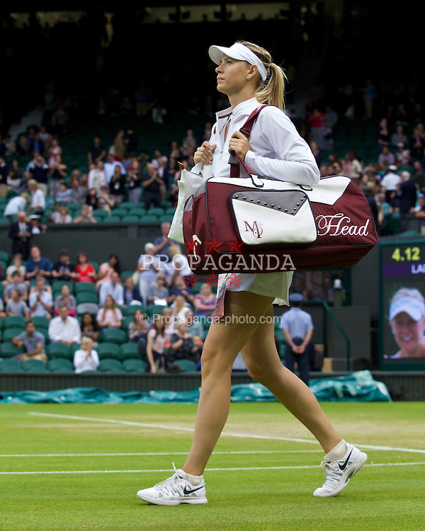 LONDON, ENGLAND - Saturday, June 28, 2014: Maria Sharapova (RUS) walks onto court before her Ladies' Singles 3rd Round match on day six of the Wimbledon Lawn Tennis Championships at the All England Lawn Tennis and Croquet Club. (Pic by David Rawcliffe/Propaganda)