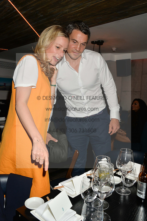 ADAM BIDWELL and TAMARA DRAX at the launch of Geisha at Ramusake hosted by Piers Adam and Marc Burton at Ramusake, 92B Old Brompton Road, London on 11th June 2015.