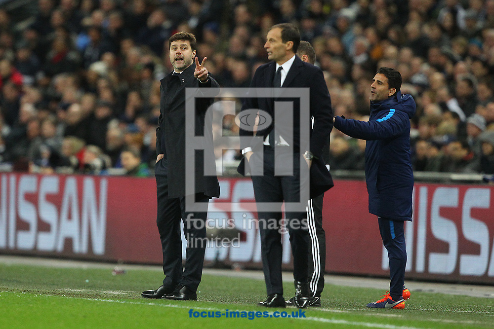 Tottenham Hotspur Manager Mauricio Pochettino lets Juventus Manager Massimiliano Allegri know exactly how he feels during the UEFA Champions League match at Wembley Stadium, London<br /> Picture by Paul Chesterton/Focus Images Ltd +44 7904 640267<br /> 06/03/2018