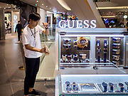 09 NOVEMBER 2018 - BANGKOK, THAILAND: A worker gets the watch shop he works in ready to open in ICONSIAM. ICONSIAM opened November 9. ICONSIAM is a mixed-use development on the Thonburi side of the Chao Phraya River. It includes two large malls, with more than 520,000 square meters of retail space, an amusement park, two residential towers and a riverside park. It is the first large scale high end development on the Thonburi side of the river and will feature the first Apple Store in Thailand and the first Takashimaya department store in Thailand.     PHOTO BY JACK KURTZ