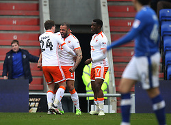 Kyle Vassell of Blackpool (C) celebrates scoring his sides first goal - Mandatory by-line: Jack Phillips/JMP - 02/04/2018 - FOOTBALL - Sportsdirect.com Park - Oldham, England - Oldham Athletic v Blackpool - Football League One