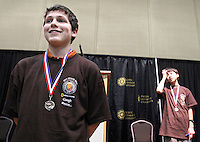 Kyler Schubkegel, 14, left, smiles after coming in second, directly following the state National Geographic geography bee, at Pacific Lutheran University, Friday afternoon, April 1, 2011.  Arjun Kumar, 13, right, who came in first advances to the national competition.  (Janet Jensen/Staff photographer) ORG XMIT: TNT1104011629028860