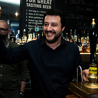 Milan, Italy - 14-04-2016: Matteo Salvini, leader of the anti-migrant and federalist Northern League (Lega Nord), pulls a pint in a pub