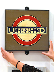 © Licensed to London News Pictures. 15/11/2012. London, UK The original Underground Roundel design from Westminster Station, Edward Johnston, c.1930. The Royal College of Art is celebrating its 175thanniversary with a major exhibition featuring more than 350 works of art and design by over 180 RCA graduates and staff, including Henry Moore, Barbara Hepworth, Tracey Emin, David Hockney, Peter Blake, Bridget Riley and Lucian Freud. The RCA is the world's oldest art and design university in continuous operation. Its first students comprised a small group of teenage boys; today it educates some 1,200 postgraduate students from 55 different countries.. Photo credit : Stephen Simpson/LNP