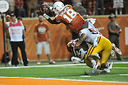 AUSTIN, TX - OCTOBER 18:  Tyrone Swoopes #18 of the Texas Longhorns dives for the end zone against the Iowa State Cyclones on October 18, 2014 at Darrell K Royal-Texas Memorial Stadium in Austin, Texas.  (Photo by Cooper Neill/Getty Images) *** Local Caption *** Tyrone Swoopes