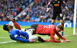Rangers' Lassana Coulibaly and Kilmarnock's Stuart Findlay collide in the penalty box during the Ladbrokes Scottish Premiership match at Ibrox Stadium, Glasgow.