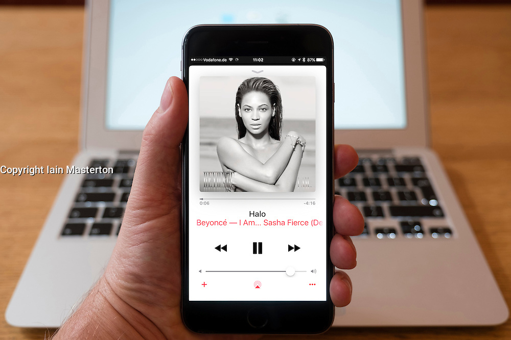 Using iPhone smartphone to display Apple Music streaming app with Beyonce artist.