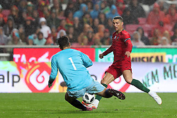 June 7, 2018 - Lisbon, Portugal - Portugal's forward Cristiano Ronaldo vies with AlgeriaÂ«s goalkeeper Abdelkader Salhi during the FIFA World Cup Russia 2018 preparation football match Portugal vs Algeria, at the Luz stadium in Lisbon, Portugal, on June 7, 2018. (Credit Image: © Pedro Fiuza via ZUMA Wire)
