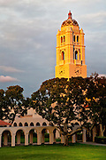 The Plummer Bell Tower on the Fullerton High School campus lit up by the setting sun. Fullerton, California.