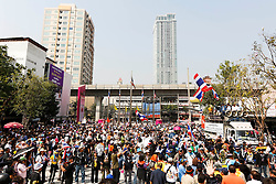 © Licensed to London News Pictures. 20/01/2014. Anti-Government Protestors march to the front of the Government Savings Bank in an attempt to shut the Bank down in Bangkok Thailand. Anti-government protesters launch 'Bangkok Shutdown', blocking major intersections in the heart of the capital, as part of their bid to oust the government of Prime Minister Yingluck Shinawatra ahead of elections scheduled to take place on February 2. Photo credit : Asanka Brendon Ratnayake/LNP