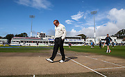 Umpire Ian Gould inspects the pitch at 11am after morning rain before for the LV County Championship Div 1 match between Sussex County Cricket Club and Somerset County Cricket Club at the BrightonandHoveJobs.com County Ground, Hove, United Kingdom on 14 September 2015. Photo by Bennett Dean.
