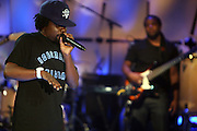 Wale performs at the Grey Goose and BET Presents ' Rising Icons ' featuring Wale held at BET Studios on July 28, 2009 in New York City