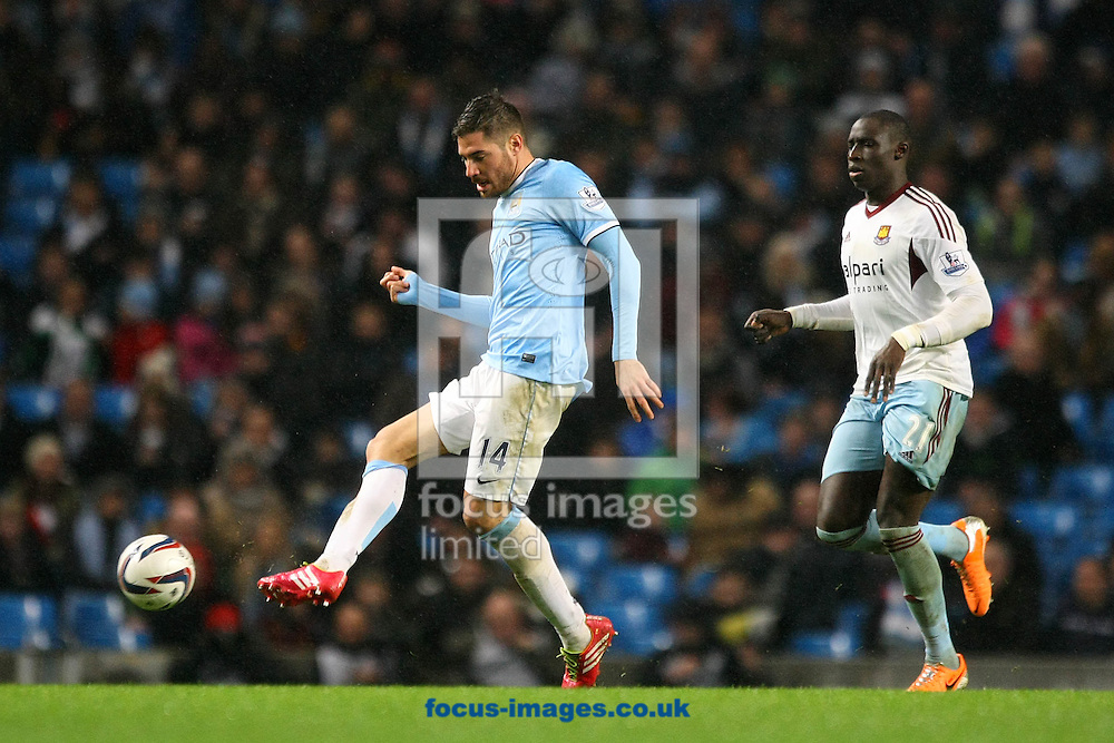 Picture by Paul Chesterton/Focus Images Ltd +44 7904 640267<br /> 08/01/2014<br /> Javi Garcia of Man City and Mohamed Diame of West Ham in action during the Capital One Cup Semi Final 1st Leg match at the Etihad Stadium, Manchester.