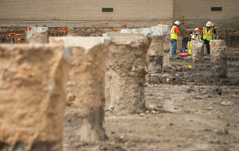 Crews inspect old pilings at the construction site of the new Worthing High School, April 16, 2014.