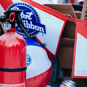 A used fire extinguisher to put out team Storm Show's fire table final round.
