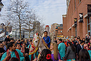 "Baltimore, Maryland - December 20, 2014: Eshwan Ramudu rides Chico, a male 22 year-old, Andalusian horse, from Mt. Airy, MD outside the Baltimore Marriott Waterfront Hotel for his baraat. Riding with Eshwan is his bride's nephew Arjun Khanna. By tradition, a young boy, the ""sarbala"" from the family who rides the with the groom as protection from others who might wish ill upon him. <br /> Trisha Satya Pasricha and Eshwan Ramudu married at the Baltimore Marriott Waterfront Hotel December 20, 2014. <br /> <br /> <br /> CREDIT: Matt Roth for The New York Times<br /> Assignment ID: 30168620A"