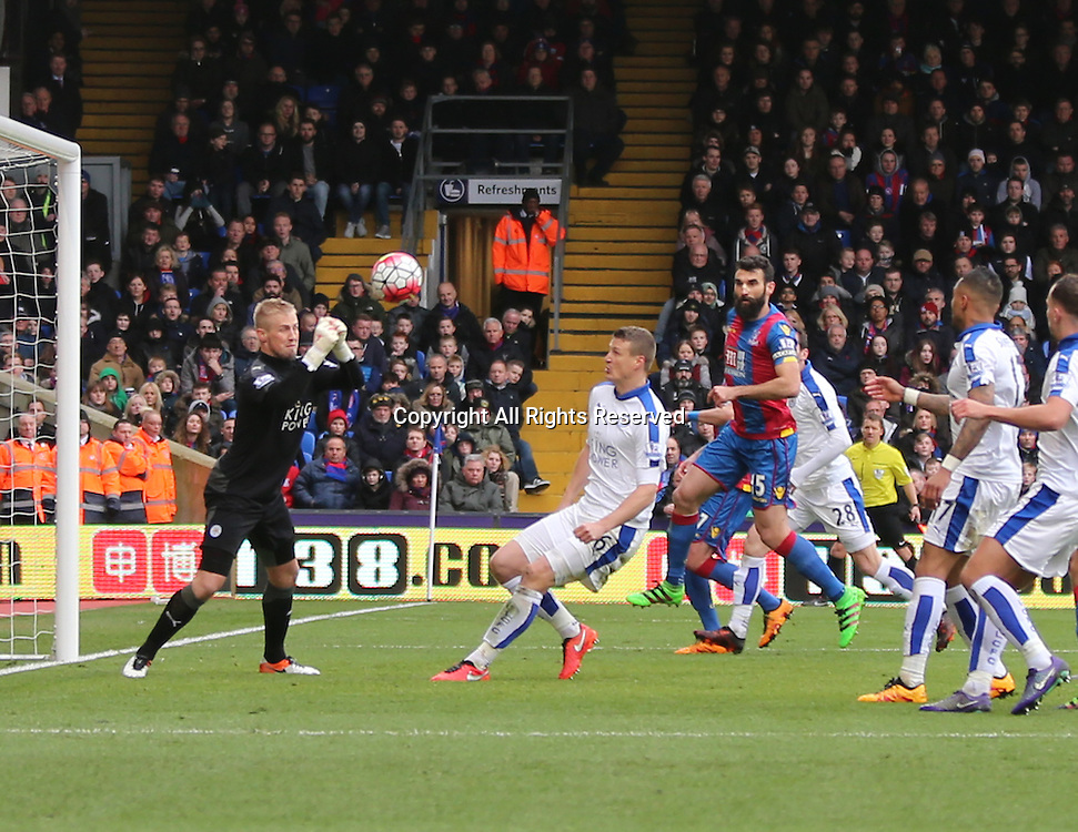 19.03.2016. Selhurst Park , London, England. Barclays Premier League. Crystal Palace versus Leicester City.   Kasper Schmeichel punches the ball out under pressure from Ledley