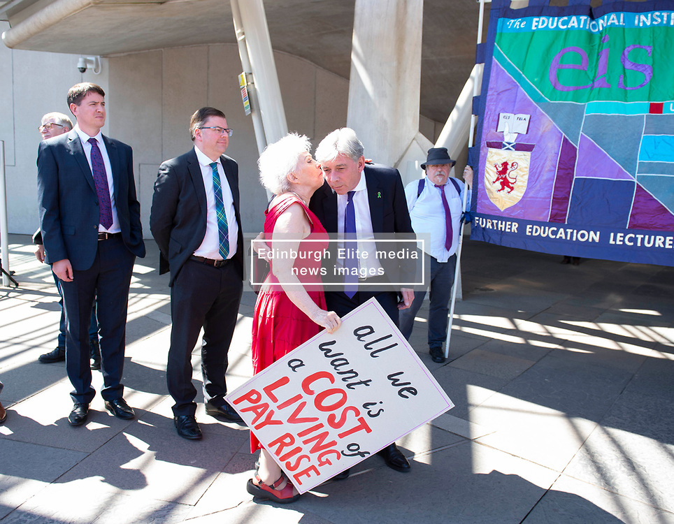 Scottish Labour Leader Richard Leonard chats with a college lecturer as EIS FELA members continue their strike action with a lobby outside of the Scottish Parliament over a cost of living pay rise. College Lecturers Strike Day Lobby of Parliament, The Scottish Parliament, Edinburgh,  Angie Isac | EEm Thursday 16 May 2019