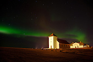 The Icelandic presidential residence at Bessastaðir in the northern lights.