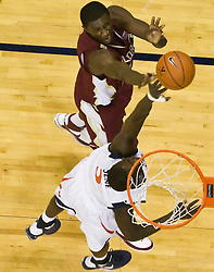Virginia center Assane Sene (5) blocks a shot by Florida State center Solomon Alabi (32).  The Virginia Cavaliers fell to the Florida State Seminoles 73-62 in NCAA Basketball at the John Paul Jones Arena on the Grounds of the University of Virginia in Charlottesville, VA on January 24, 2009.