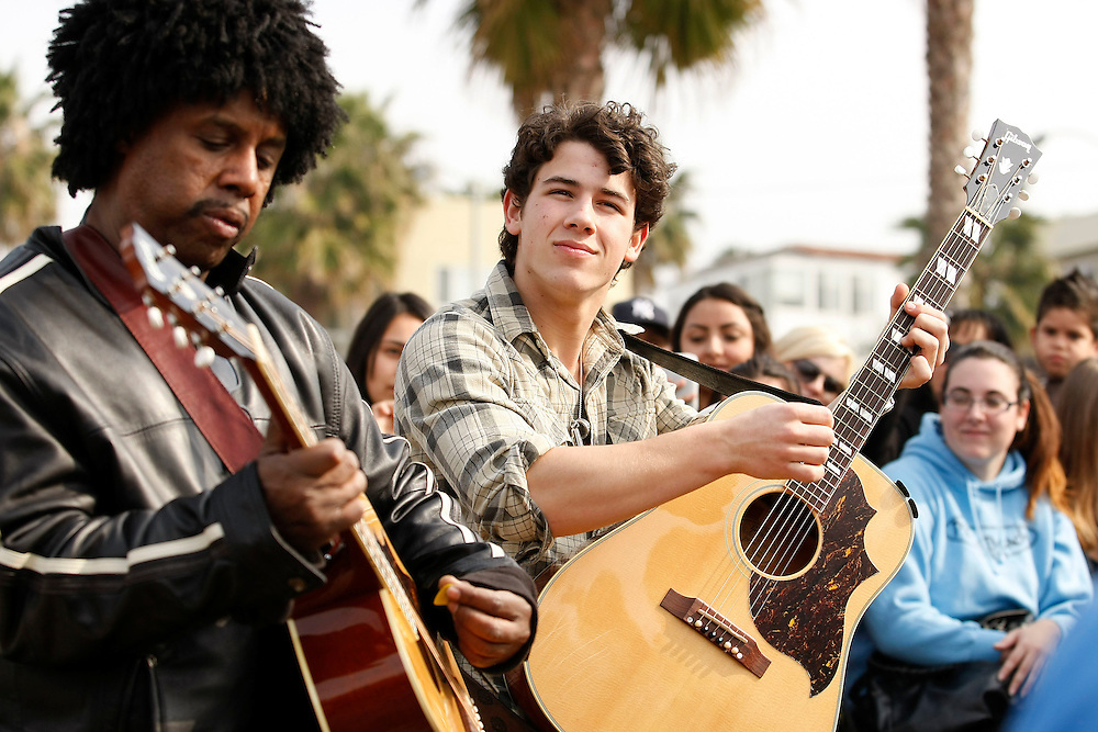 SANTA MONICA, LOS ANGELES. February 2nd 2010.<br /> <br /> Nick Jonas put on an impromptu acoustic session for his fans, on the beach near Santa Monica pier. He was performing with the new guitarist in his band 'The Administration' - Sonny Thompson. Sonny Thompson replaced former guitarist David Ryan Harris for the 2010 tour. Photograph: James Breeden/Nate Jones &copy; PacificCoastNews.com **FEE MUST BE AGREED PRIOR TO USAGE** **E-TABLET &amp; MOBILE PHONE APP PUBLISHING REQUIRES ADDITIONAL FEES** UK OFFICE: +44 131 557 7760/7761 US OFFICE: +1 310 261 9676