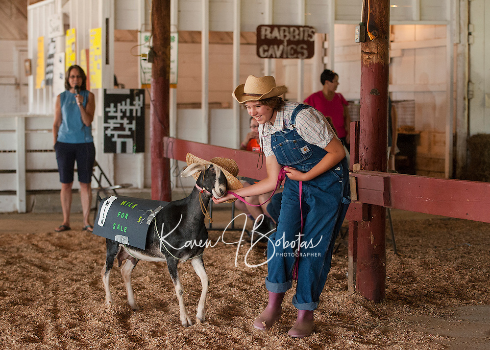 """Caitlynn Hammond and her Alpine Nubian Cross Goat """"Amy"""" have a little fun in the Costume Class judging on Sunday morning at the 4H Fair at the Belmont Fairgrounds.  (Karen Bobotas/for the Laconia Daily Sun)"""
