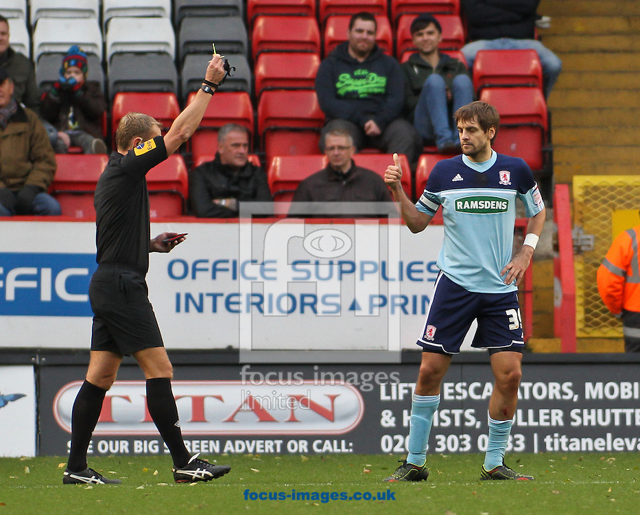 Picture by David Horn/Focus Images Ltd +44 7545 970036.03/11/2012.Jonathan Woodgate of Middlesbrough is booked during the npower Championship match at The Valley, London.
