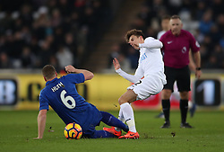 Leicester City's Robert Huth (left) and Swansea City's Tom Carroll during the Premier League match at the Liberty Stadium, Swansea.