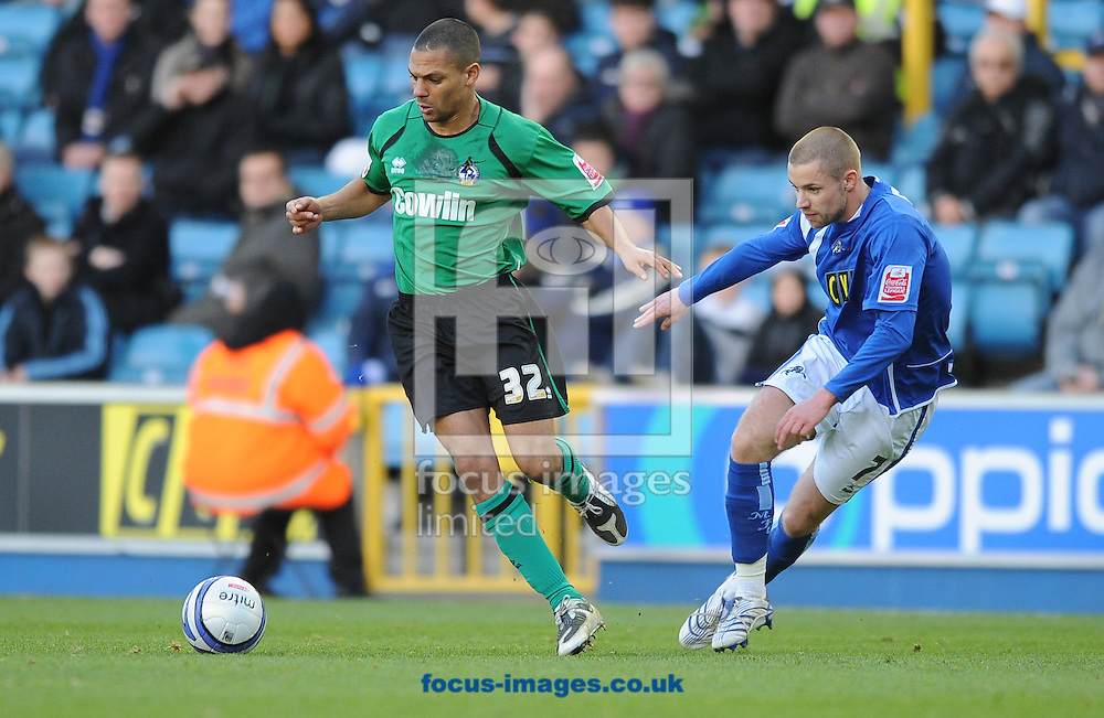 London - Saturday, December 6th, 2008: Alan Dunne of Millwall and Aaron Lescott of Bristol Rovers during the Coca Cola League One match at The Den, London. (Pic by Alex Broadway/Focus Images)