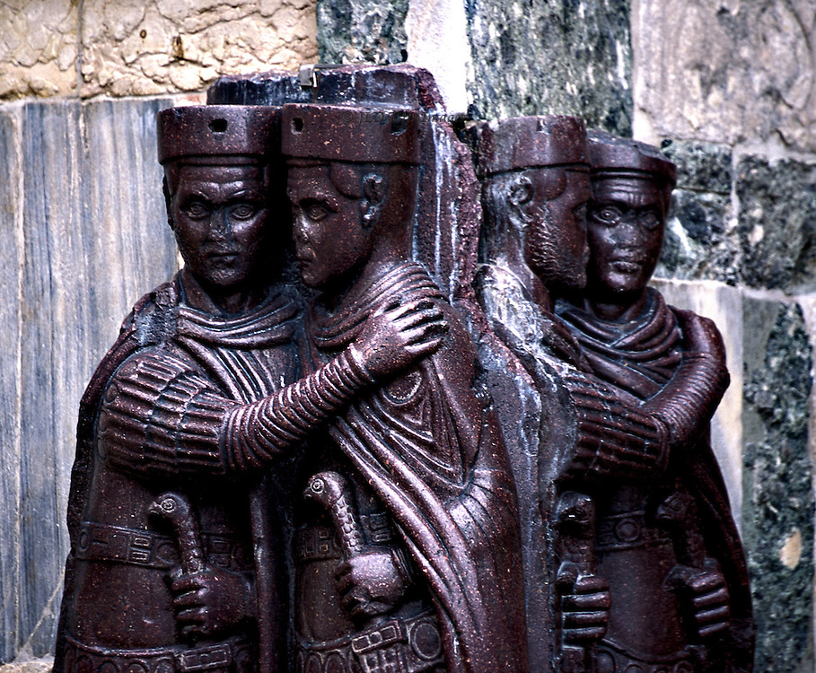 The Tetrarchs, porphyry sculptures on wall of San Marco, Venice. View of all four figures, each pair embracing.