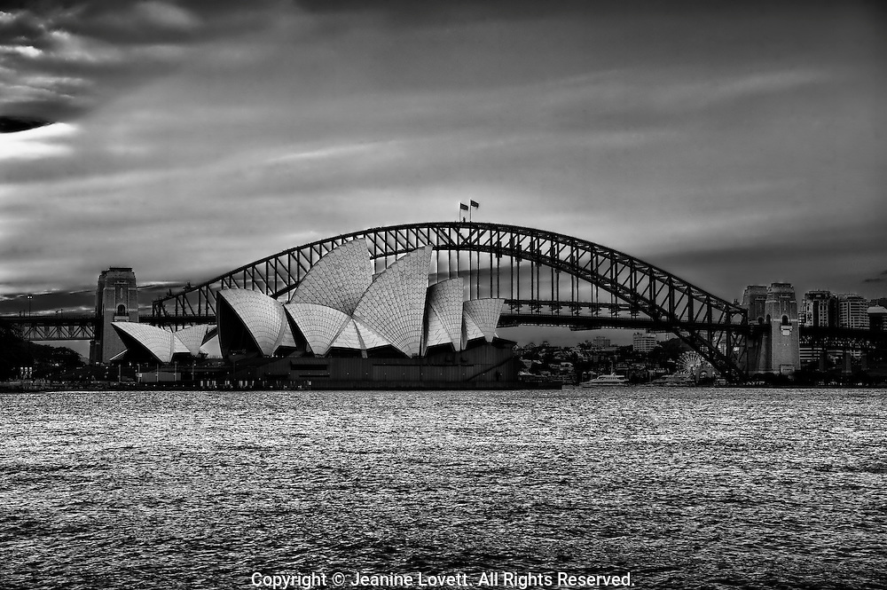 Sydney Harbour Bridge with Sydney opera house in front.