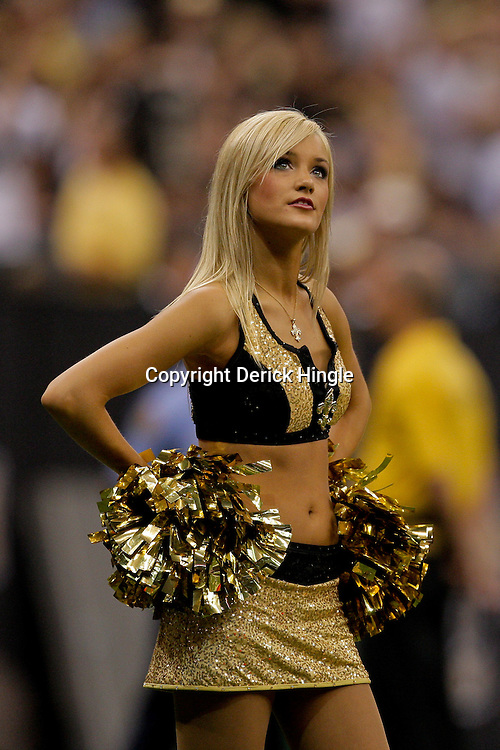 2009 October 04: New Orleans Saints Saintsations cheerleaders on the sideline during a 24-10 win by the New Orleans Saints over the New York Jets at the Louisiana Superdome in New Orleans, Louisiana.