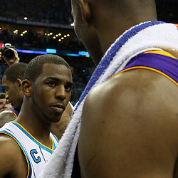 April 28, 2011; New Orleans, LA, USA; New Orleans Hornets point guard Chris Paul (3) and Los Angeles Lakers shooting guard Kobe Bryant (24) talk following game six of the first round of the 2011 NBA playoffs at the New Orleans Arena. The Lakers defeated the Hornets 98-80 to advance to the second round of the playoffs.   Mandatory Credit: Derick E. Hingle