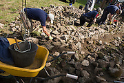 Wallers from the South West England Dry Stone Walling Association (SWEDSWA) demonstrate dry stone wallers in Priddy, Somerset. Across the UK, there are over 150,000 miles of wall in a state of disrepair. The members of SWEDSWA try to do their bit to rebuild some of those across the South West of England, demonstrating and educating their trade skills to the general public at country events such as this - a sheep fair held annually since 1348.