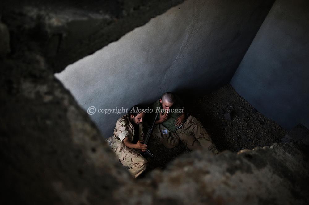 LIBYAN ARAB JAMAHIRIYA, Um al Far : Libyan rebel fighters rest in a building in Um al Far after they took control of the village, on July 28, 2011. ALESSIO ROMENZI